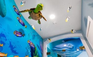 3d turtle and fish sculptures suspended from entranceway ceiling