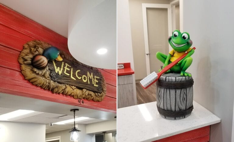 A sculpted wooden welcome sign with hay & duck accents and a custom frog mascot for a dental office reception