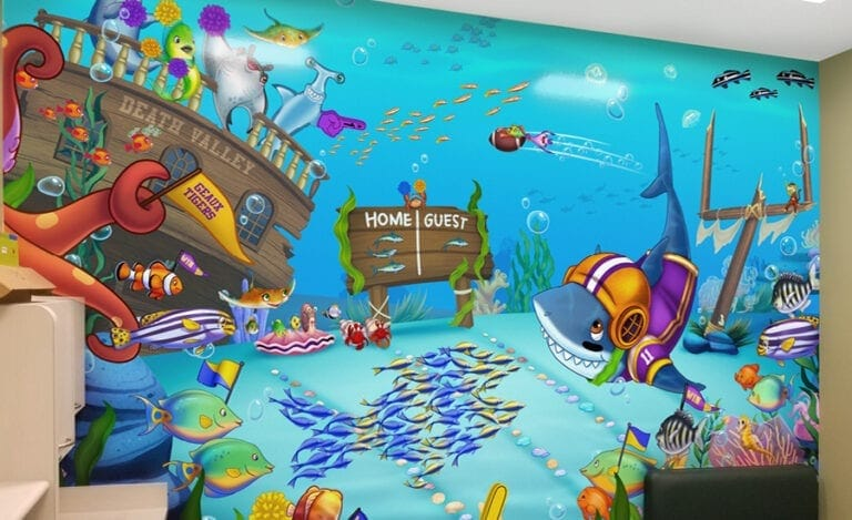 Colorful mural of an underwater football game with sea creatures cheering on local sports teams