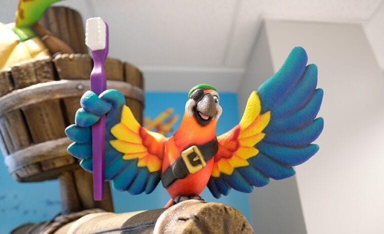 Colorful parrot holding a toothbrush sculpted on top of a ship's mast in a pediatric dental practice
