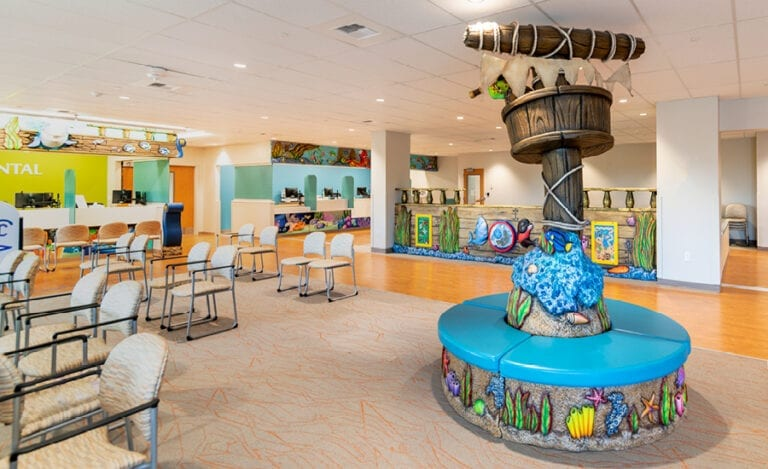 community medical clinic waiting room with underwater shipwreck themed reception desk