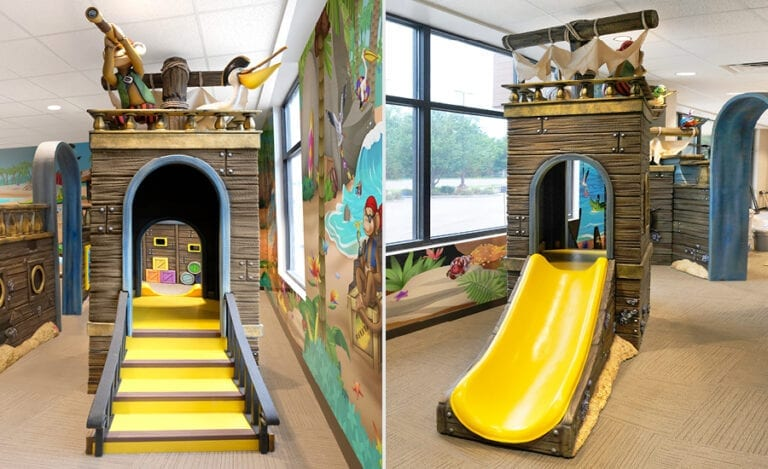 Custom kid's slide themed with pirate ship inspired cladding and characters