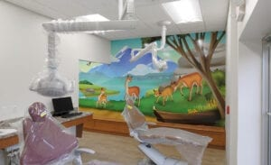 Dental open bay with a kid friendly mural of the Andes Mountains and South American animals