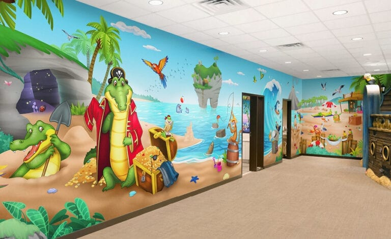 Full wall mural in kids area of custom pirate theme featuring a beach theme with buried treasure and crocodiles