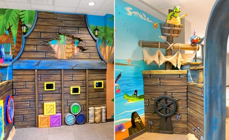 Game tablets and play panels on a custom pirate ship wall with pirate turtle and parrot characters in waiting room