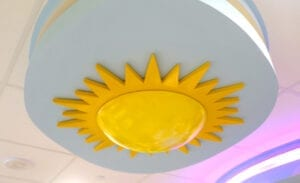 Sculpted stylized sun in a hospital waiting room ceiling