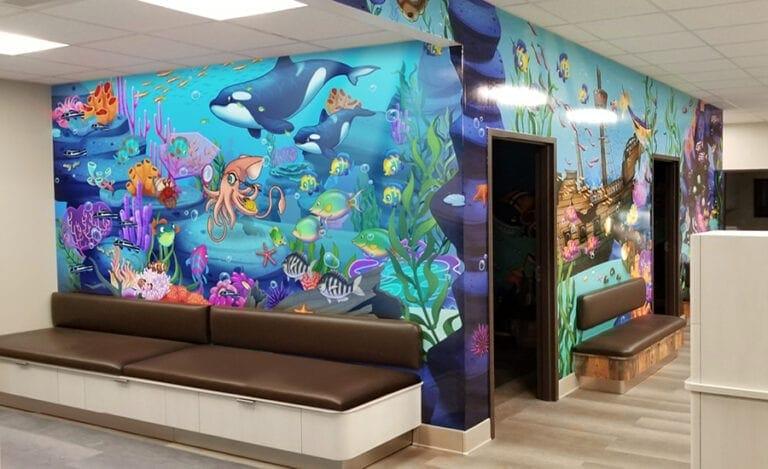 Sunken ship mural featuring underwater animals in an orthodontist waiting room