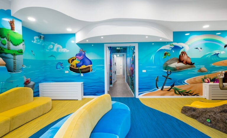 beach themed wall murals in kids waiting room play area