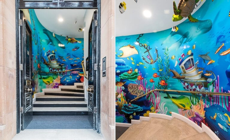 entranceway staircase with wrap around ocean mural