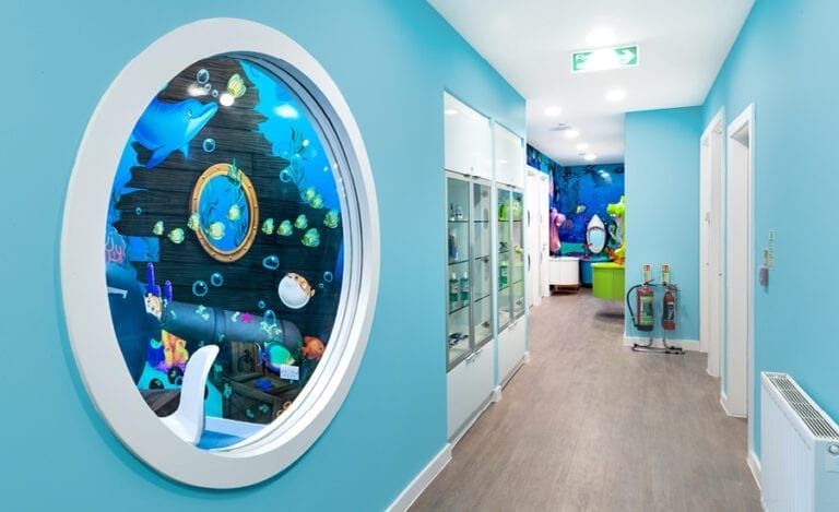 hallway with porthole window showing ocean mural within