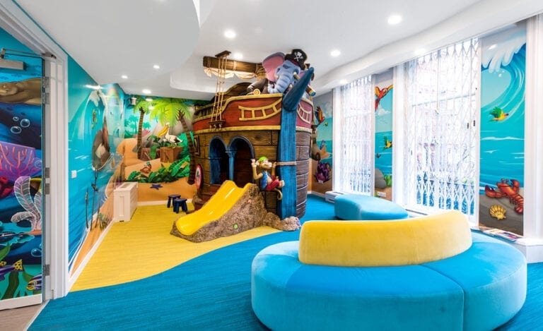 pirate ship themed play area and murals in kids dentist office