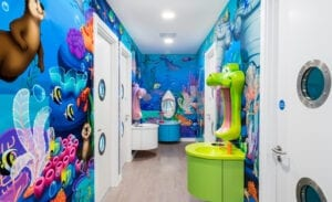 underwater themed brushing area with animal mirrors and murals