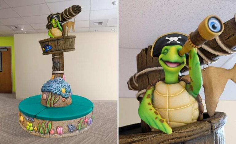 underwater-themed circular bench with pirate turtle character in a crow's nest in medical reception area