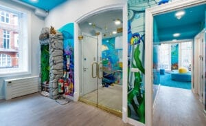 underwater themed reception area with murals and prize tower in pediatric dental office