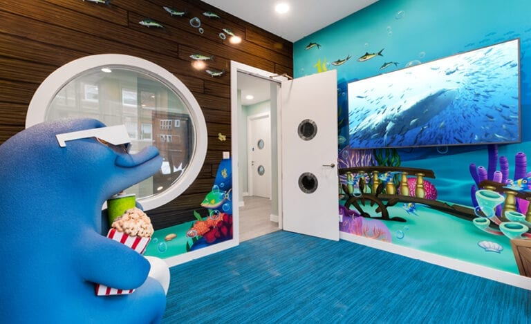 underwater themed wall murals in kids theater in dentist office
