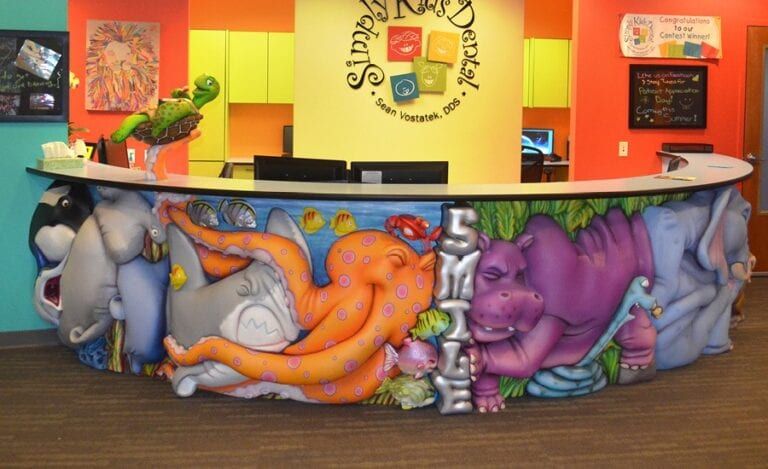 jungle and marine themed reception desk with squished animal characters