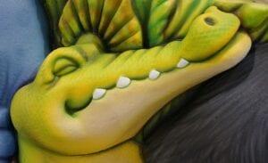 detail of sculpted crocodile head for a pediatric clinic reception desk