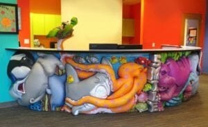 funny underwater and tropical themed pediatric reception desk with fighting marine animals