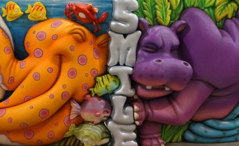 marine and jungle animals pushing against each other on a custom themed pediatric reception desk
