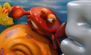 sculpted crab character with other undersea animals for a dual theme reception desk