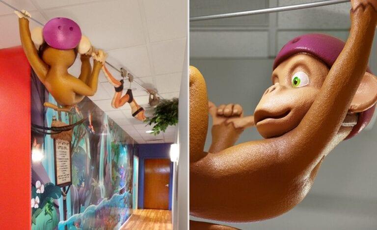 sculpted monkey ziplining above hallway in a pediatric office