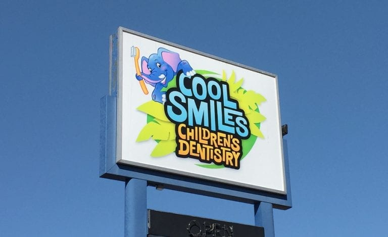fun logo for a children's dental office with leaves and an elephant