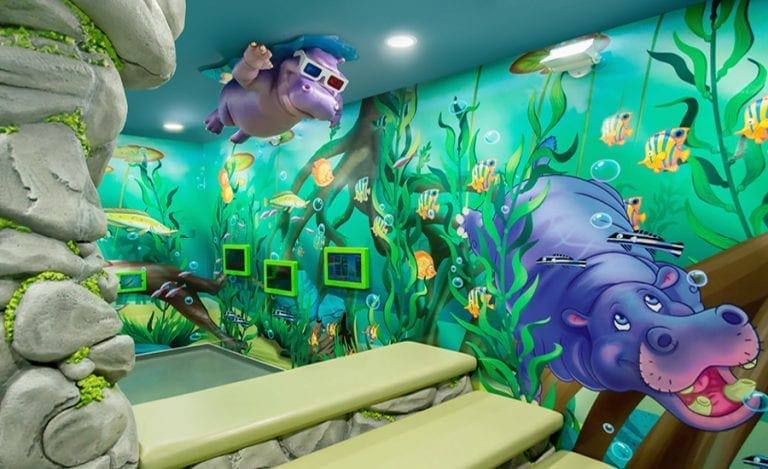 jungle themed theater and games room in a pediatric dental office
