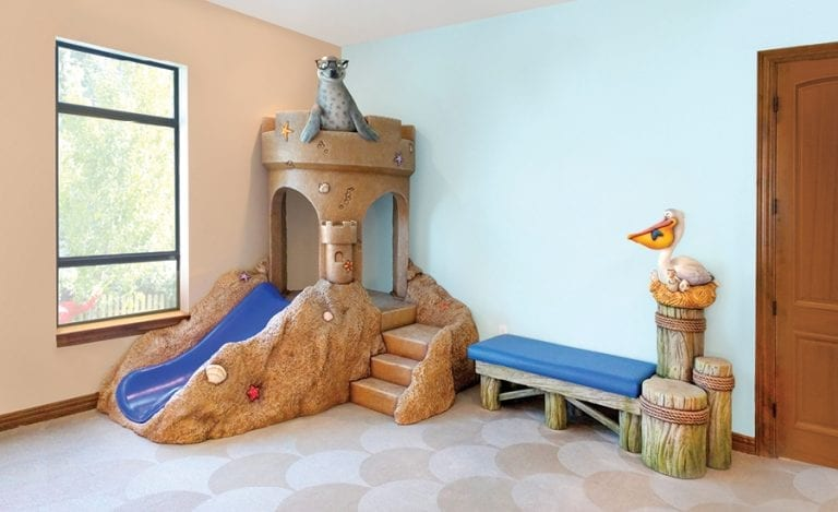Sandcastle slide and dock pillar bench with fun beach characters.