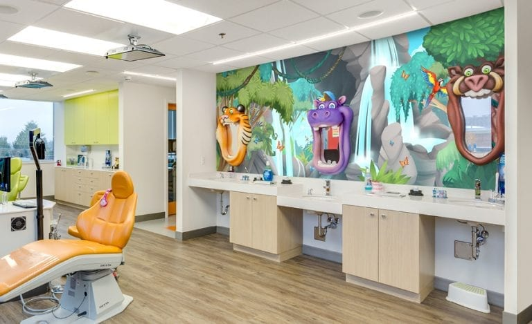 Dental brushing station with a jungle mirror featuring a 3D tiger, hippo, and boar shaped brushing mirrors.