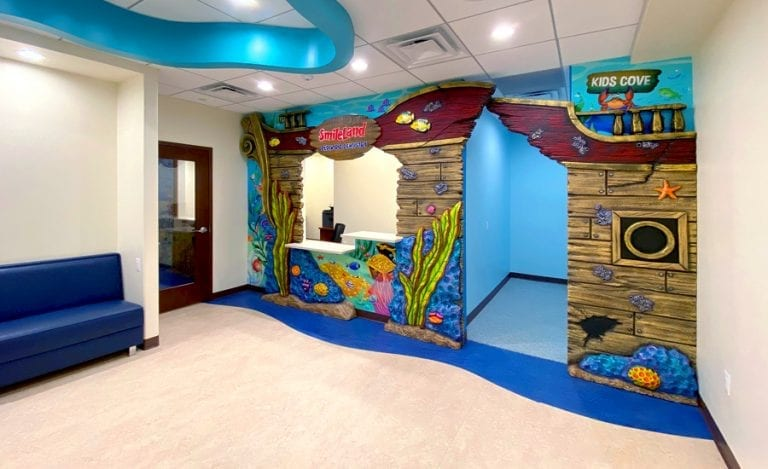 Undersea themed reception desk with small children's area on the side.