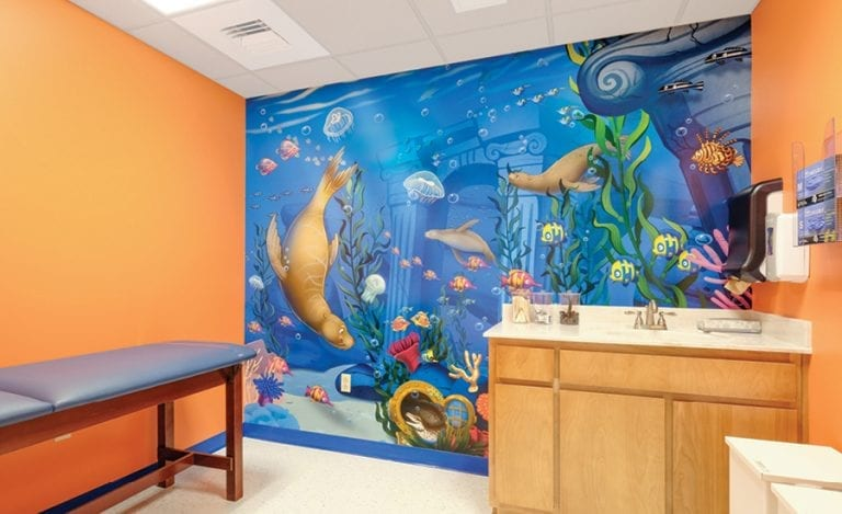Medical exam room with an underwater mural.