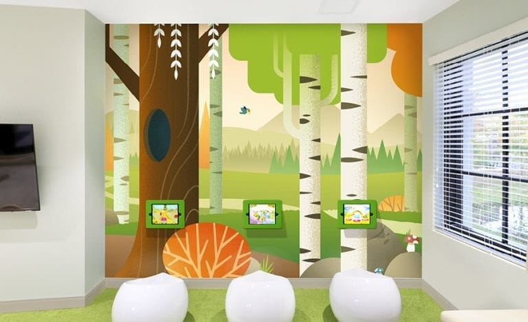 Fall forest wall mural with seating and 3 gaming tablets for children.