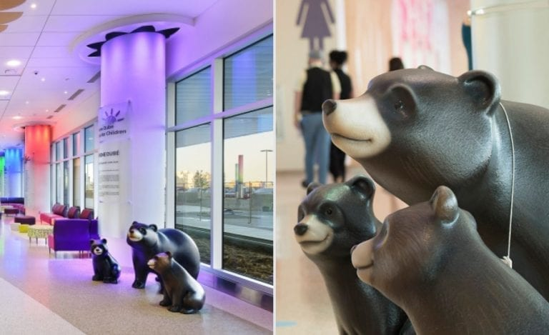 Sculpted mama bear with two baby bears in a hospital hallway