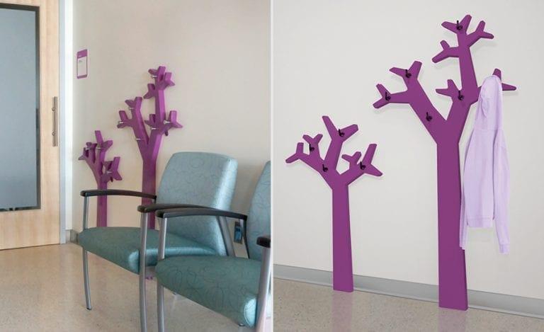 Minimalistic purple tree coat hangers in a modern pediatric hospital.