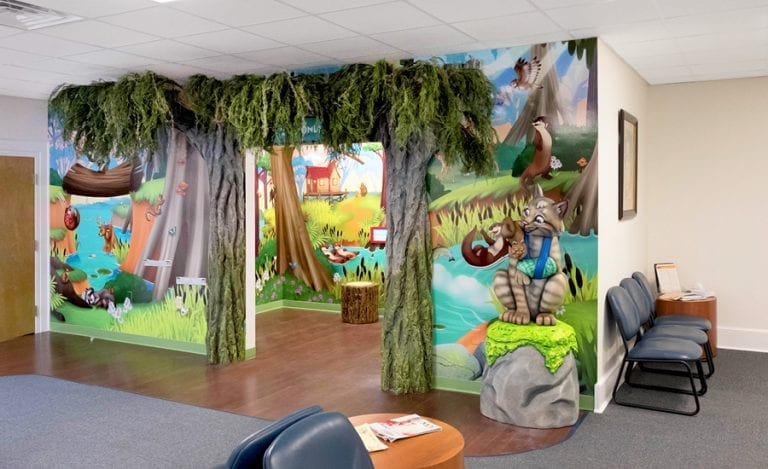 bayou themed medical office waiting room with sculpted bobcat and custom mural