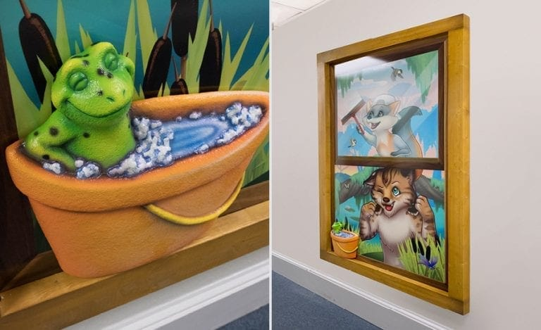 3D sculpted frog in a pail of water and wall mounted window mural with panther and raccoon