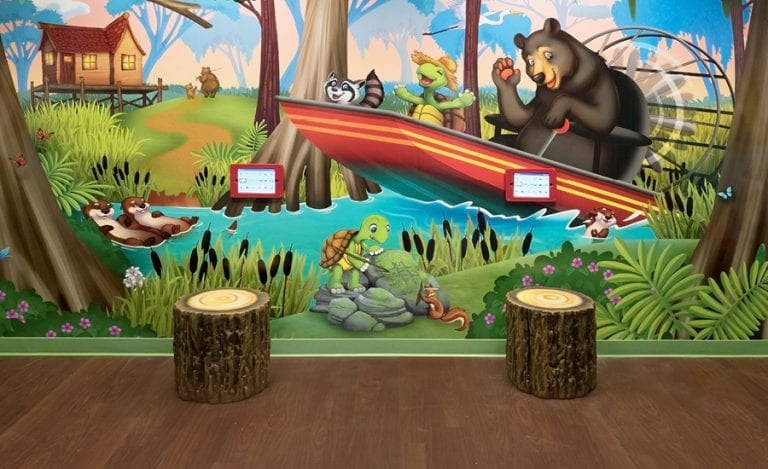 custom mural with kee bee gaming stations for kids
