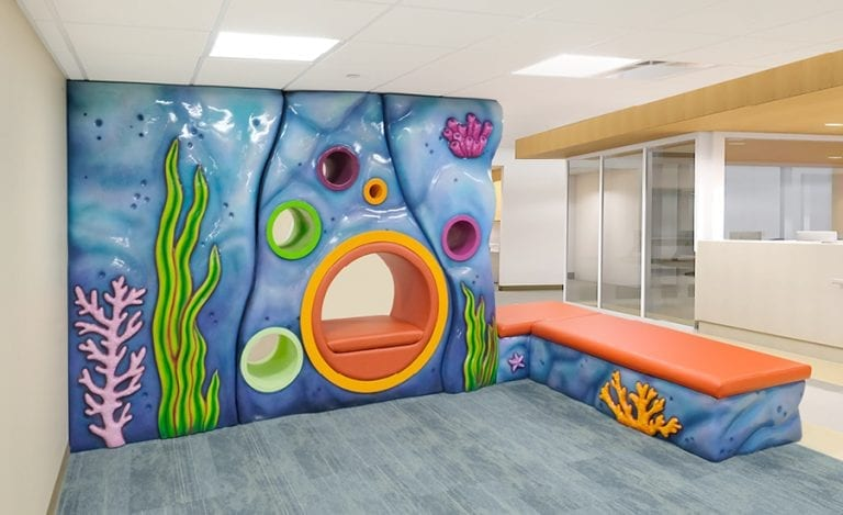 sculpted faux rock wall with built in seating for childrens' hospital