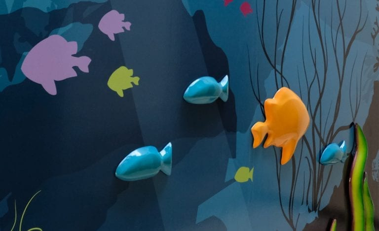 custom underwater themed mural with wall mounted sculpted fish
