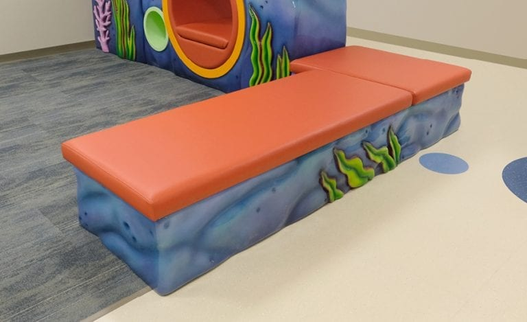 underwater rock themed bench seating for hospital waiting area