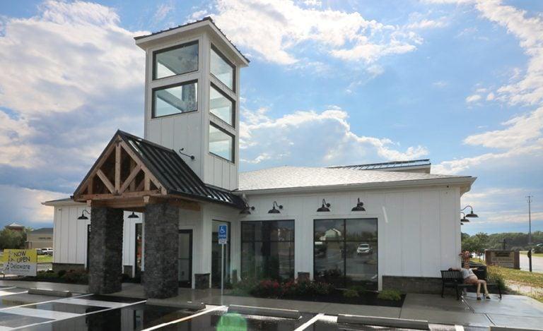 An exterior shot of a dental office with a giraffe sculpture.